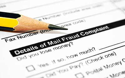 What Is Mail Fraud? Definition, Examples, and Penalties
